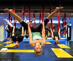 Exhilarating: Alice is 'inverted' during her AntiGravity yoga class