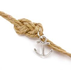 The sailor's knot has been a lasting symbol of true love for centuries. Here is is beautifully matched to a small metal anchor, a symbol of steadfastness and the seas. This beautiful homage to love an