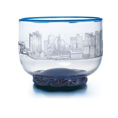 Boston Skyline Bowl, featuring some of the City's landmarks including the Custom House, Old North Church, and the USS Constitution. Made of handblown glass in Massachusetts exclusively for Shreve, Crump & Low