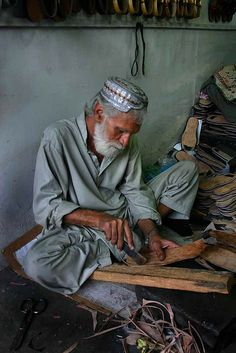 Karachi, Pakistan:     A cobbler or maker of shoes in the central market of Karachi-Pakistan.