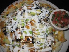 BOARDNER'S NACHOS  $8 Choice of Beef or Chicken! With Our Freshly Made Tortilla Chips and Layered with Jalapenos, Jack & Cheddar Cheese, Black Beans, Avocado, Freshly Diced Tomato,  Salsa & Sour Cream