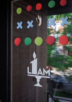 So smart! Cut contact paper shapes to make removable birthday party front door decorations - I used Handmade Charlotte stencils. #birthdayparty #kidsbirthdays #decorations