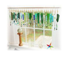 This stained glass ornament valance would look absolutely incredible when the light shines through! You can find more like this on LittleLaLaOriginals Etsy shop