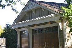 Garage Pergola - grey home with wooden doors looks cool!