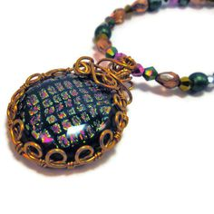 Wire wrapped dichroic necklace by MiSuenos on Etsy, $25.00