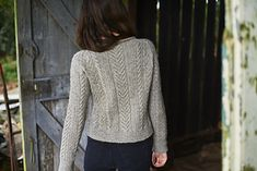 This raglan jumper is knitted seamlessly in the round from the bottom up. Sleeves and body are worked separately to the underarms, then joined to knit the yoke. Short rows are worked to shape the neckline before finishing with a rolled neckband. All cable motifs are charted, and are worked over a six-row repeat.