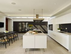 bulthaup b3 kitchen finished in Alpine White laminate and a contrasting sawn Black Oak veneer. This kitchen enjoys not just one but 3 Gaggenau Vario Wine Cabinets - designed by Sapphire Spaces | bulthaup Exeter