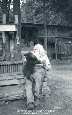 A real-life Grizzly Adams! This is a photo of a man named Spikehorn Meyers who ran a bear refuge in Michigan in the He's considered one of the state's most colorful characters and was known as the Bear Whisperer. from > Old Photo Archive Vintage Pictures, Old Pictures, Old Photos, Grizzly Adams, Into The West, Edmund Dulac, Tier Fotos, Le Far West, Mountain Man