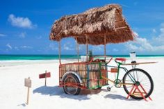Exotic beach bar transformed from bike at Caribbean beach in Mexico Stock Photo - 9773700