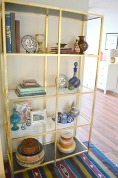 Get the look: DIY gold leafed IKEA VITTSJÖ shelving unit on 'Home Sweet Home' blog!