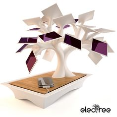 Electree is a modern sculpture imitating a bonsai, the leaves of which are small photovoltaic panels. It allows to recharge your mobile devices without using any other energy than light.   Usage is strictly limited to indoors.