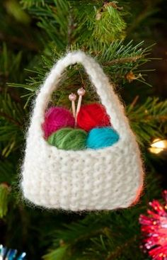 "Yarn Basket Ornament Knitting Pattern @Red Heart: This is the perfect ornament to give all your yarn loving friends, and even those who never touch a needle… they'll remember that their ""friend who knits"" gave it to them."