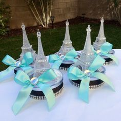 Small centerpiece 6 tall, the Eiffel Tower is made it with plastic decorated with some rhinestones and ribbon. Price is for 6 centerpieces You can use it as a centerpiece if you tied ballon son the top ( ballon holder) or as a party favor. The base is a plastic box , you can fill it with your favorite candies, the box is 4 diameter Perfect for wedding, 15 años, paris party, baby shower, etc We also can change the color if you dont like pink.