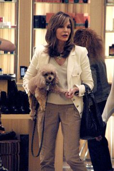 """Jaclyn Smith Photos - Former """"Charlie's Angel""""  Jaclyn Smith and her pet pooch have a mooch around Barney's New York in LA. - Jaclyn Smith at Barney's New York in LA"""