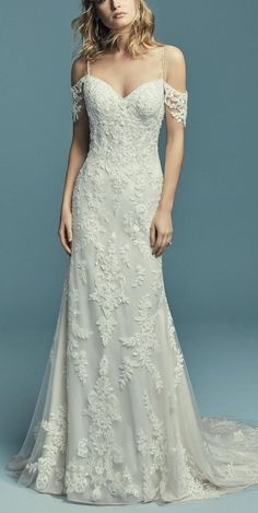 ANGELICA by Maggie Sottero Wedding Dresses Maggie Sottero – ANGELICA, Soft and elegant, this sheath wedding dress features cascading lace motifs over tulle. Elegant Wedding Dress, Perfect Wedding Dress, White Wedding Dresses, Designer Wedding Dresses, Bridal Dresses, Wedding Gowns, Bridesmaid Dresses, Wedding Ceremony, Cold Shoulder Wedding Dress