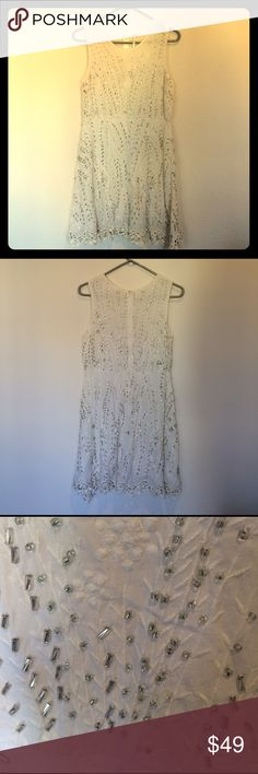 Free people beaded dress. White. Size 6 White dress with silver beading by Free People. A-line silhouette. Never worn. Size 6. Free People Dresses