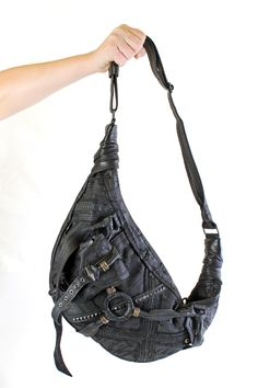 Made from printed canvas and leather, this is an incredible purse. It features one large main pocket with zipper closure and 1 interior zipper pocket. There are a bunch of leather straps and oxidized Leather Bags Handmade, Leather Craft, Pocket Holster, Denim Bag, Leather Pouch, Festival Fashion, Badass, Fashion Forward, Purses And Bags