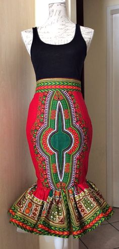 Dashiki skirt (red). Red dashiki midi skirt with flared bottom. Fully lined with mesh at the bottom for fullness. Size 8. Can be made to order in various colors. Ankara | Dutch wax | Kente | Kitenge | Dashiki | African print bomber jacket | African fashion | Ankara bomber jacket | African prints | Nigerian style | Ghanaian fashion | Senegal fashion | Kenya fashion | Nigerian fashion | Ankara skirt (affiliate)