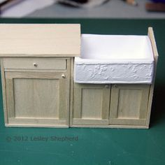 How to make a miniature farmhouse sink and cabinet.