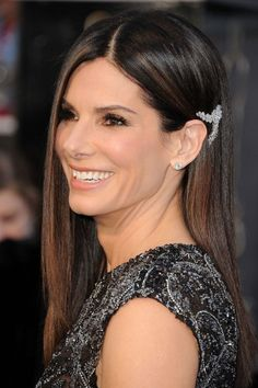 Sandra Bullock    With her bejeweled Elie Saab gown, Sandra Bullock could have gone with a traditional, Old Hollywood take on glamour. She didn't, though, and here's why we're so stoked. Those sooty eyes piqued our interest, but we didn't see this next bit coming: a single jeweled barrette, placed so close to her left ear that it reminded us of the badass ear jewelry at Rodarte's spring '13 runway show.