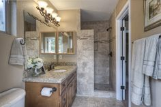 Alair Homes | Phoenix | Remodel The bedroom is neatly and elegantly built to ensure maximum conform and luxury. Adjacent to the master bedroom is a fully equipped bathroom that includes Granite countertop with double sinks and a shower.