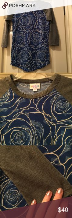 """🦄LuLaRoe Randy blue and white roses/gray sleeves Perfect condition and washed per LLR standards. Xxs fits true to size. Top to bottom center is 26"""" so it could be worn as a tunic for a smaller person. 18"""" across, small in the sleeves. Amazing LLR! Make an offer! Smoke free pet free home LuLaRoe Tops"""