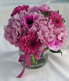 Sweet Pink florals with lush array of pink hue floralls in our glass cylinder vase  $85.00