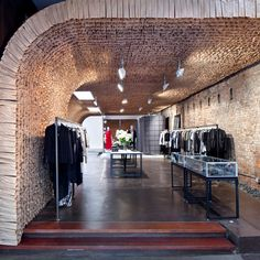 Jeremy Barbour is the man responsible for the striking construction of the store, an 1800 sq ft space in the city's Meat Packing District. He used 25,000 brown paper bags to form a continuous floor-to-ceiling tunnel, which creates quite a buzz for the customer...