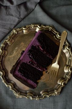 Chocolate and blackberry cake - three layers of moist chocolate cake with blackberry jam, backberry swiss meringue buttercream and blackberry ganache