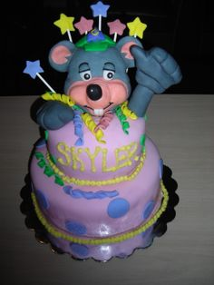 Chuck E Cheese Birthday Cake - This is the 1st cake I have ever made using fondant for a figure and to cover the cake. My Daughter turned 3 in May this year and we had her birthday party at Chuck E Cheese. She LOVES Chuck E so naturally, I wanted to make a special cake for her party. I thought my cake turned out pretty good considering it was my first attempt. The top tier of the cake was a coconut cream and the bottom was a gourmet chocolate, both covered with butter cream and then fondant…
