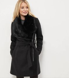 The Secrets Of Best Winter Outfits: How To Dress Stylishly In Winter - woman in faux fur trimmed casual coat