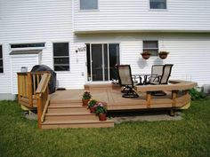 Timbertech Twinfinish Cedar colored deck with Flaired Stairs and Bench in Delaware OH, Columbus OH