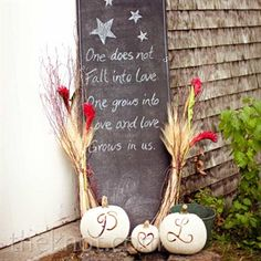 A chalkboard welcome sign greeted guests -- white-painted pumpkins added a touch of autumn.