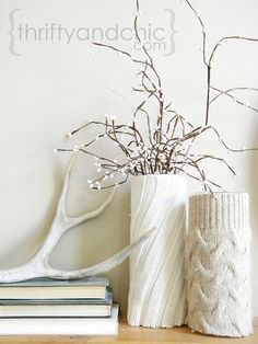 What a cute idea.  Love the painted driftwood accompanying the vases too.  Some people are so crafty.