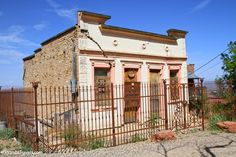 You must read the true story of the owner of this house...The Ghost of the Cuban Queen Bordello. Written by Peggy Hicks who is a store owner in Jerome. A must read!  Jerome, Arizona
