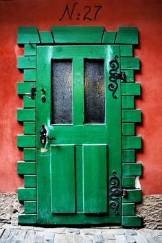 Green door with swirly hardware...niceeeee!Brought to you by Cookies In Bloom and Hannah's Caramel Apples   www.cookiesinbloo... www.hannahscarame...