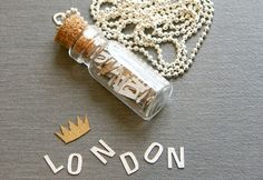 Love this unique Message in a Bottle necklace. The bottle is filled with up to 50 letters and symbols that spell out a special place, name, or message. By Bespoke Custom
