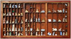 Wade figurines all organized in a cute wall cubby... I have this at home!