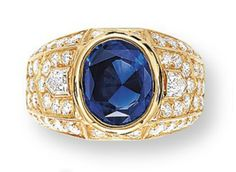 A SAPPHIRE AND DIAMOND RING, BY CARTIER   Centering upon an oval-shaped sapphire within pavé-set diamonds of chevron outline, to the polished gold half-hoop, mounted in 18k yellow gold, ring size 5½, with French assay mark for gold, in red leather Cartier case    Signed and with maker's mark for Cartier Paris, No. 230401