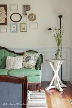 Love this eclectic gallery wall and the gorgeous vintage green sofa eclecticallyvintage.com