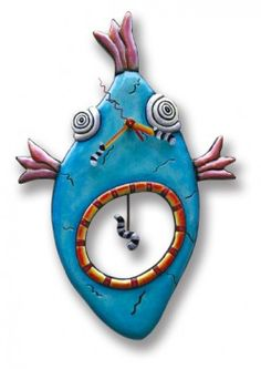 "$59 Fish Face Hand Painted Resin Wall Clock with swinging worm and hook pendulum. * Requires one AA battery (not included).  * All clock mechanisms are warranted for two years.  * Measures 10""W x 14.5""H (including pendulum). #quirksofart"