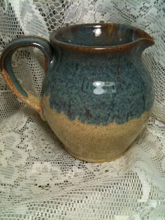 Varigated Blue and Eggshell glaze with Waterfall Brown around top and handle. Glazes are from Ron Roy and Hesselberths Mastering cone 6 glazes.