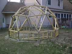 Geodesic Dome Greenhouse built with beams and pipe hubs. It has an IBC tote aquaphonics system in it and strawberry towers. Geodesic Dome Greenhouse, Strawberry Tower, Concrete Blocks, Wood Screws, Beams, Construction, Backyard, Building, Homes