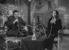 Gomez and Morticia Addams are such a romantic couple ever! Although they are odd...they love with romantics word in each shot...awh TV land..