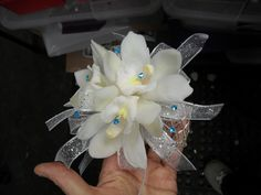 silver , white and blue corsage for wedding and prom.