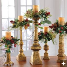 Dover Antique Gold Candlesticks... So elegant with the greenery & berries!! Would make fabulous Christmas wedding decor!!