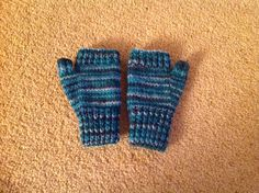 A pair of simple fingerless gloves .....