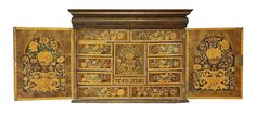 A William and Mary marquetry cabinet of drawers, with finely worked floral panels on every surface, the cushion frieze drawer over a pair of doors, enclosing an arrangement of eleven drawers, around a central cupboard, with three internal drawers, 110cm wide 50cm deep 84cm high