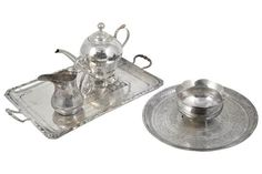 AN IRAQI SILVER THREE-PIECE TEA SET AND TRAY, UNMARKED, CIRCA 1944 decorated in niello work with