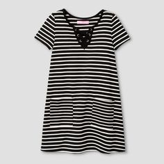Just because she's a modern girl doesn't mean she can't enjoy classic style, like this Striped A-Line Dress from Say What?. Classic black and white stripes decorate this tee-style dress, while a lace-up front and large pockets give it a more up-to-date look. This comfy, casual dress can be worn for everything from riding her bike to sitting in class, and looks great with solid or patterned tights to be a versatile year-round wardrobe pick.
